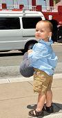 Boy On The Sidewalk