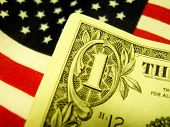 Dollar Bill On The American Flag poster