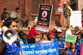 KATHMANDU, NEPAL - NOV 29, 2013: Unidentified participants protest within a campaign to end violence