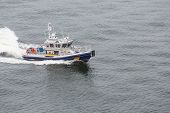 stock photo of nypd  - A New York City Police Boat Speeding Across the Harbor - JPG