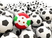 stock photo of burundi  - Football with flag of burundi in front of regular balls - JPG
