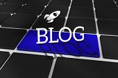 The word blog and rocket ship against black keyboard with blue key