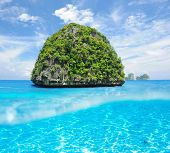 Beautiful uninhabited island in Thailand with white sand bottom underwater and above water split vie