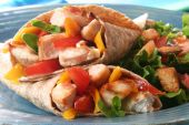 foto of sandwich wrap  - Delicious summer meal grilled chicken and vegetables wrapped in a whole wheat tortilla - JPG