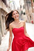 Asian beautiful woman in summer dress walking and running joyful and cheerful smiling in street. Pre
