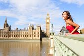London woman on Westminster Bridge by Big Ben, England. Beautiful tourist girl sightseeing travel on