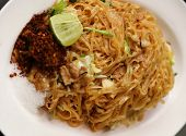 image of rice noodles  - Stir fried rice noodle on plate (Korat