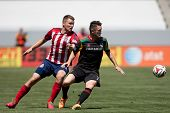 CARSON, CA - APRIL 6: Chivas USA D Eriq Zavaleta (22) & Los Angeles Galaxy F Robbie Keane (7) during
