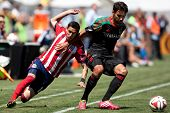 CARSON, CA - APRIL 6: Los Angeles Galaxy M Baggio Husidic (6) and Chivas USA D Eric Avila (15) durin