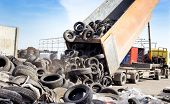 image of trash truck  - Truck tipping old used tires for recycling