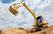 pic of sand gravel  - excavator machine at excavation earthmoving work in sand quarry - JPG
