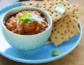 vegetable ragout dip from eggplant and tomato with crisps