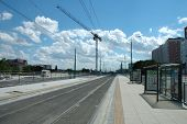 Empty Tram Stop, Track And Crane In Poznan, Poland