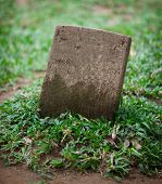 image of empty tomb  - The old Small gravestone among the grass - JPG