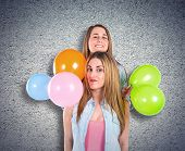 Friends With Many Balloons Over Textured Background