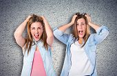 Frustrated Girls Over Textured Background
