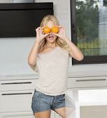 Funny Blond Girl Doing Orange Glasses