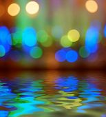 Street lights bokeh background reflection in water