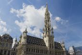 Brussels Town Hall, Grand Place, Belgium. Clouds And Blue Sky.