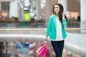 Attractive woman with shopping bags at the supermarket