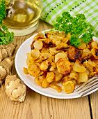 picture of jerusalem artichokes  - Jerusalem artichokes fried in a dish fresh tubers of Jerusalem artichoke napkin parsley vegetable oil on a wooden boards background - JPG