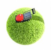 image of grass-cutter  - lawnmower on green grass on white background - JPG