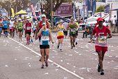 Tired Competitors Compete In Comrades Ultra Marathon