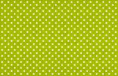 Light green fabric with white polka dots