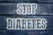 picture of diabetes symptoms  - Stop Diabetes Concept text on background idea - JPG