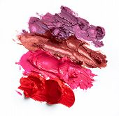 foto of lipstick  - Smudged lipsticks isolated on the white background - JPG