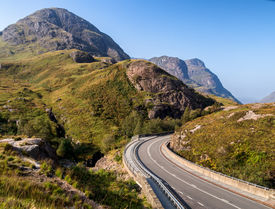 stock photo of three sisters  - The new section of road passing through Glencoe at the meeting of the waters with the Three Sisters in background - JPG