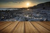 Long Exposure Landscape Rocky Shoreline At Sunset With Wooden Planks Floor