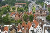 Aerial view to the old city and Holstentor city gate in Lubeck, Germany.