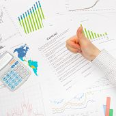 Business Man Working With Financial Data - Thumb Up