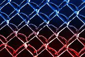 pic of chain link fence  - A close up abstract background image of a color inverted chain link fence - JPG