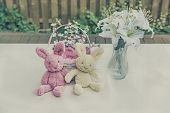 Plush Easter Bunnies With Basket And Lilies