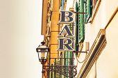 Bar Sign On The City Street