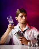 pic of bartender  - Young stylish man bartender preparing serving alcohol cocktail drink over bar counter - JPG