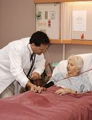 stock photo of hospice  - doctor visiting senior woman patient in hospice - JPG