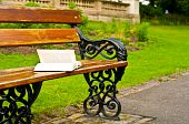 Abandoned Book On A Park Bench