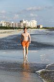 Teenager Enjoys Jogging Along The Beach