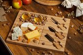 Cheese platter with various cheeses.