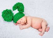 sweet  baby boy sleep in a green knitted hat