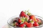 Fresh Organic Long Stem Strawberries in a Bowl.