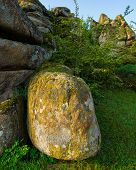 pic of old stone fence  - old stone blocks against the sky spring season - JPG