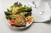 image of cod  - cod fillet breaded and baked with potatoes and salad as garnishing - JPG