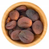 Sun Dried Apricots In Wooden Bowl Isolated.
