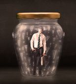 Business man trapped in jar with exclamation marks concept on bakcground