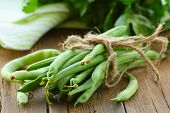 organic green peas on a wooden table, rustic style