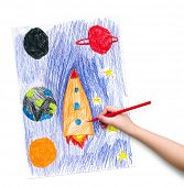 space ship. children drawing hand with crayon.